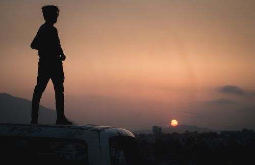 Man,cherishing,the,evening,moments,and,sun,about,to,set.