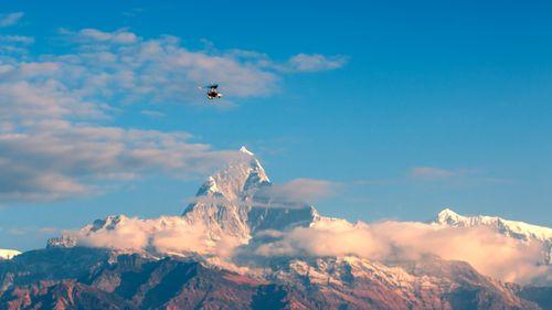 Flying,ultralight,over,the,Mount,Fishtail,range,,Pokhara,,Nepal
