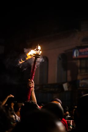 torch,god,man,carries,fire,guide,masked,dancers,crowd,indrajatra,nepals,biggest,street,festival