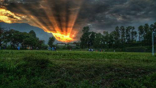 sunset,view,stop,raining,students,playing,football,pokhara,university,ground