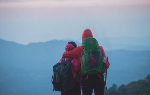 friends,enjoying,view,mesmeric,mountain