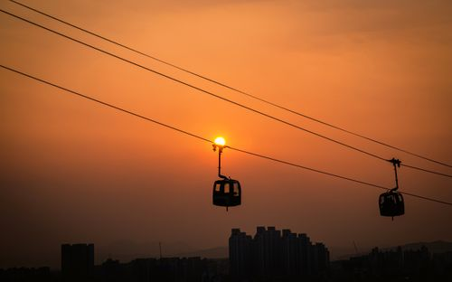 gloomy,sunset,moving,cable,car