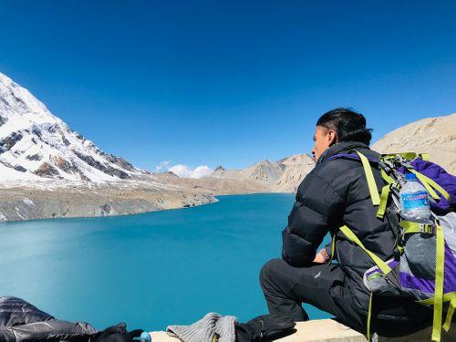 man,black,jacket,trekking,bag,enjoying,beautiful,view,tilicho,lake