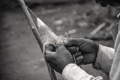 man,making,fishing,net