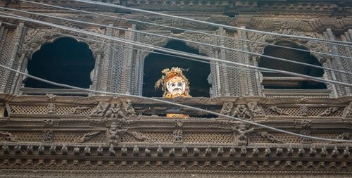 mannequin,nepalese,god,sits,window,museum,bhaktapur