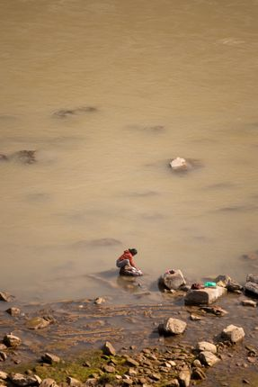 woman,washes,clothes,banks,trishuli,river