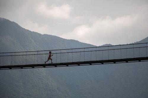 kid,running,suspension,bridge