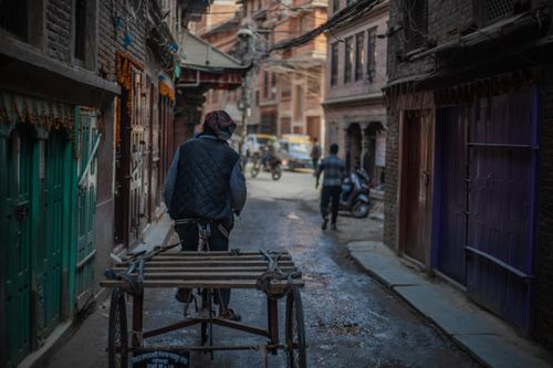 man,pedaling,rikshaw,narrow,streets,patan,nepal