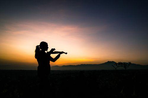 young,lady,enjoying,play,violin,sunrise,kathmandu,nepal