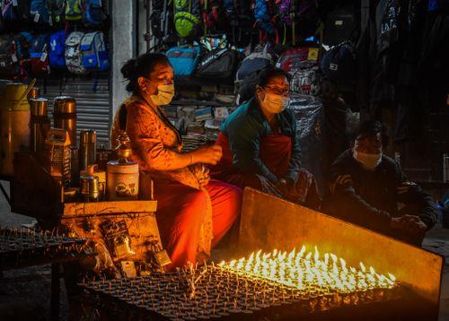women,selling,tea,butter,lamps,evening,boudhanath,stupa