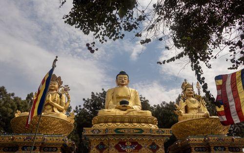 golden,statue,buddha,park,swayambhunath,kathmandu,nepal
