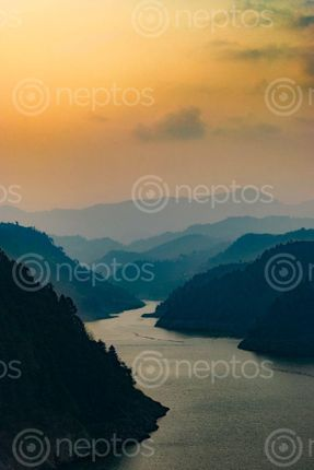 Find  the Image a,clear,view,of,the,surrounding,hills,and,the,waterlogged,area,of,the,Kulekhani,Dam,,the,largest,reservoir,based,hydroelectricity,plant,of,Nepal and other Royalty Free Stock Images of Nepal in the Neptos collection.