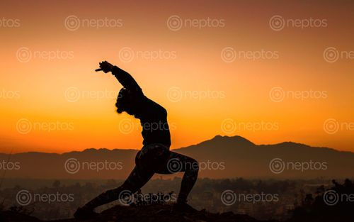 Find  the Image doing,Yoga,early,morning,at,Chobar,,Nepal. and other Royalty Free Stock Images of Nepal in the Neptos collection.