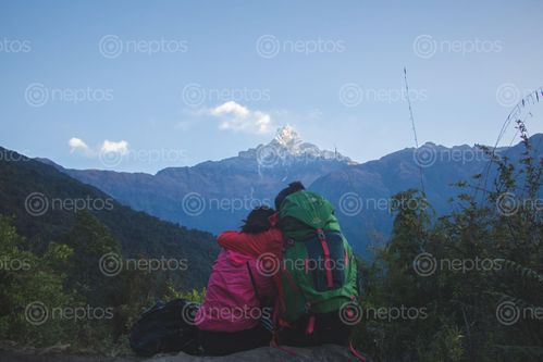 Find  the Image friends,enjoying,beautiful,view,mountain  and other Royalty Free Stock Images of Nepal in the Neptos collection.