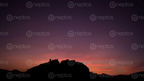 Find  the Image picture,displays,silhouette,santaneshwor,mahadev,temple,located,jharuwarasilalitpur,natural,color,graded,background,sunsets  and other Royalty Free Stock Images of Nepal in the Neptos collection.