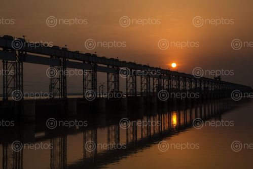Find  the Image koshi,barrage,sluice,river,carries,vehicular,bicycle,pedestrian,traffic,saptari,district,sunsari,nepal,international,border,india,constructed,agreement,signed,government,april,earlier,days,sorrow,bihar,due,flooding,monsoon,drought,winter,pride,completed,side,indo-nepal,purpose,irrigation,flood,control,hydropower,generation,spurs,eastern,embankments,km,long,originating,mt,everest,worlds,highest,glaciers,—,tibetan,plateau,enters,northern,state,finally,ends,confluence,gangas,travelling,world,horizontally,change,years,capacity,cusecs,peak,twelve,wide,embankment,served,silt,trap,raising,bed,higher,surrounding,alluvial,plane  and other Royalty Free Stock Images of Nepal in the Neptos collection.