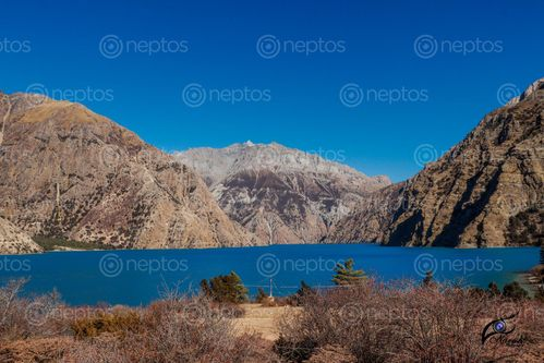 Find  the Image shey-phoksundo,lake,considered,beautiful,exotic,tourist,destinations,located,dolpo  and other Royalty Free Stock Images of Nepal in the Neptos collection.