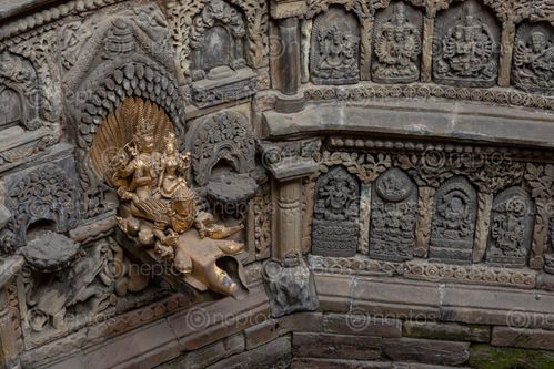 Find  the Image stone,artifact,carving,hindu,gods,wall,patan,durbar,square,nepal  and other Royalty Free Stock Images of Nepal in the Neptos collection.