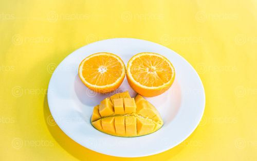 Find  the Image flat,lay,colorful,fruit,collection,slice,orange,mango  and other Royalty Free Stock Images of Nepal in the Neptos collection.